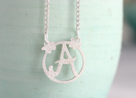 small decorated initial necklace